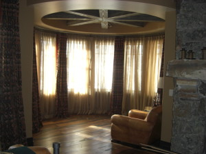Curved Custom Iron Rods Sheer and Panel Overlay